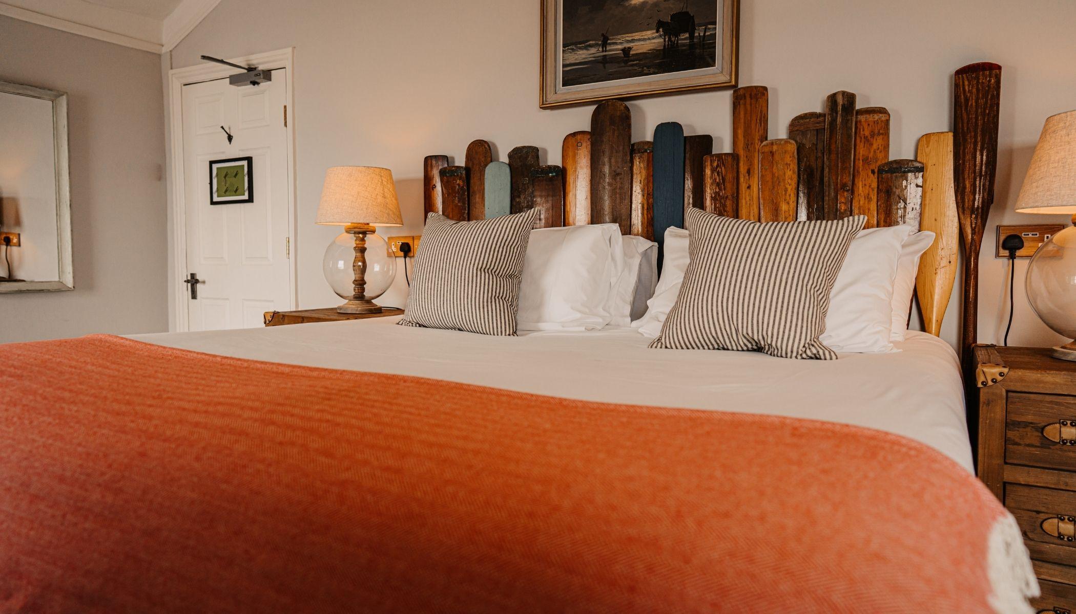 Room With Oar Headboard