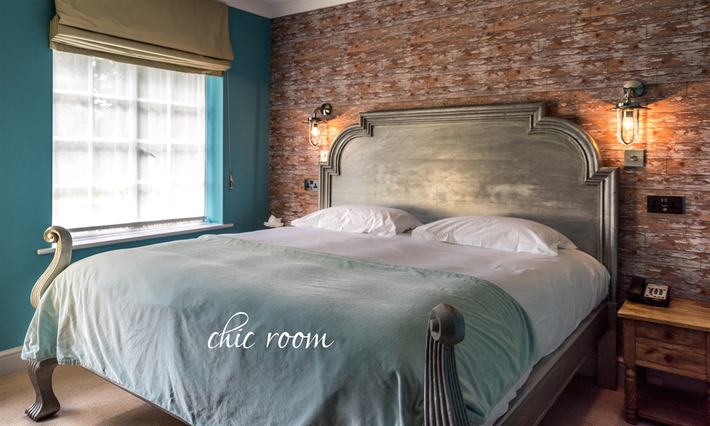 Chic bedroom at Pangbourne hotel